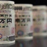 JAPAN - JANUARY 08:  Japanese 10000 yen notes are arranged for a photograph in Tokyo, Japan, on Thursday, Jan. 8, 2009. The yen rose for a second day against the dollar after rockets fired from Lebanon struck northern Israel, prompting investors to seek the perceived safety of Japanese assets.  (Photo by Tomohiro Ohsumi/Bloomberg via Getty Images)